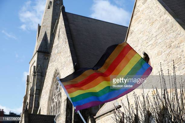 An LGBTQ flag flies over Union United Methodist Church in the South End of Boston on Jan 5 2020 On Epiphany Sunday as local Methodists celebrated the...