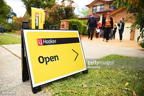 An LJ Hooker Ltd open house sign stands on display outside a house in the suburb of Roseville in Sydney Australia on Saturday Oct 18 2014 Sydneys...