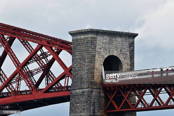 An LNER London to Aberdeen express train on the Forth Bridge, as Covid-19 restrictions on travel and tourism are eased, on April 28, 2021 in South...