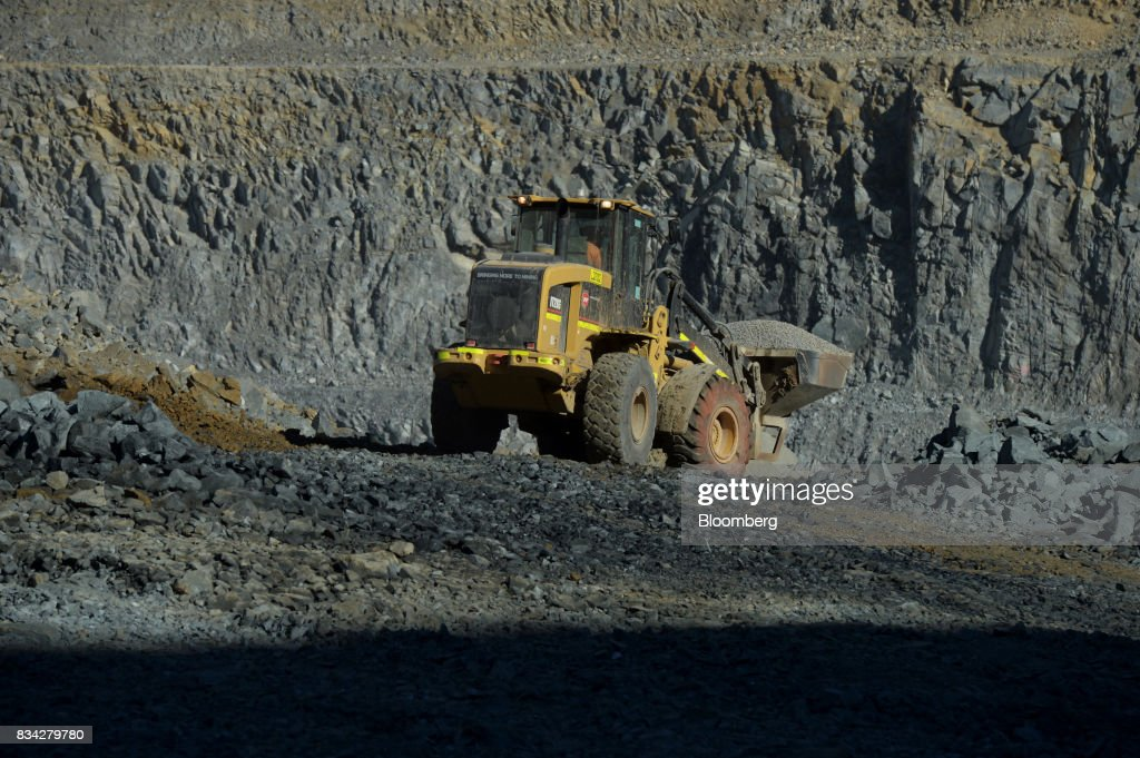 An loader works in the White Foil open mine pit at Evolution Mining Ltd.'s gold operations in Mungari, Australia, on Tuesday, Aug. 8, 2017. Photographer: Carla Gottgens/Bloomberg via Getty ImagesEvolution Mining is Australias second-largest gold producer. Photographer: Carla Gottgens/Bloomberg via Getty Images