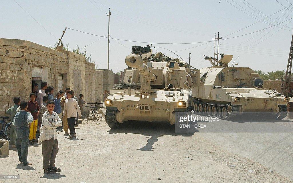 An M-109 artillery howitzer and an ammunition carrier from