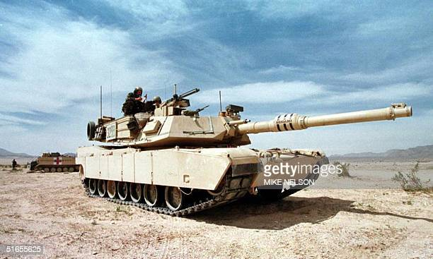 An M1A1 Abrams tank guards a position during the Advance Warfighting Experiment at the Fort Irwin Army National Training Center in Fort Irwin CA 16...