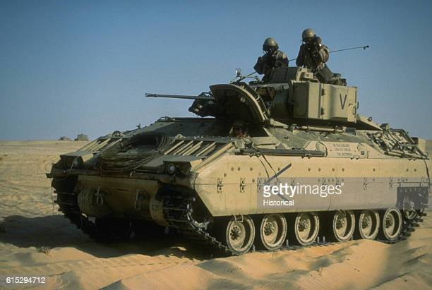 An M2 Bradley infantry fighting vehicle of the 24th Infantry Division arrives at an encampment during Operation Desert Shield Saudi Arabia 19901991