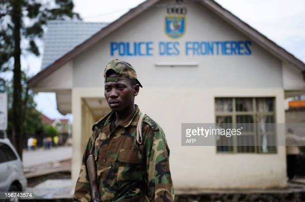 "An M23 rebel soldier stands at the ""Grande barrière"" border post with Rwanda in the eastern Congolese city of Goma on November 20, 2012. Following..."