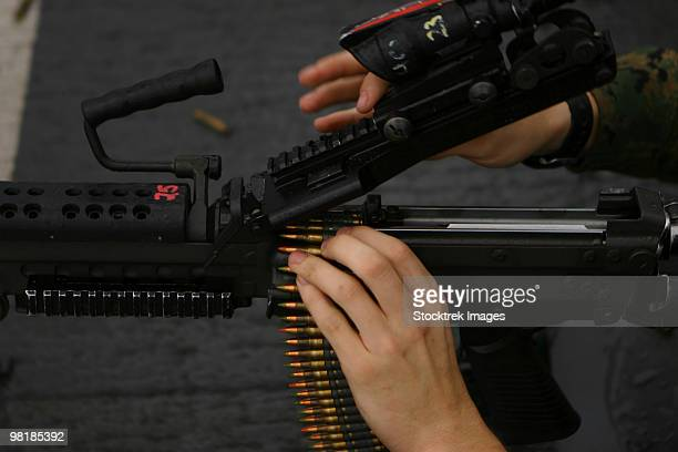 an m-249 squad automatic weapons is loaded with 5.56mm rounds. - machine gun stock pictures, royalty-free photos & images