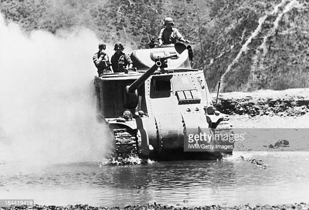 The Burma Campaign 19411945 The Battle of ImphalKohima March July 1944 An M3 Lee tank crosses a river north of Imphal to meet the Japanese advance...