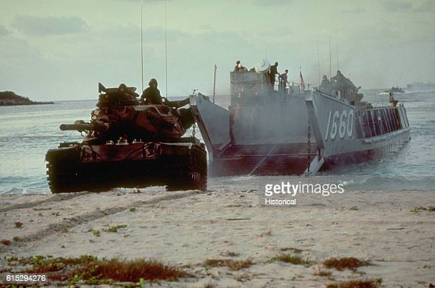 An M60 main battle tank rolls onto the beach from a utility landing craft assigned to Assault Craft Unit Two This operation is part of the joint...