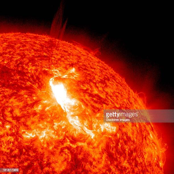 an m8.7 class flare erupts on the sun's surface. - solar flare stock pictures, royalty-free photos & images