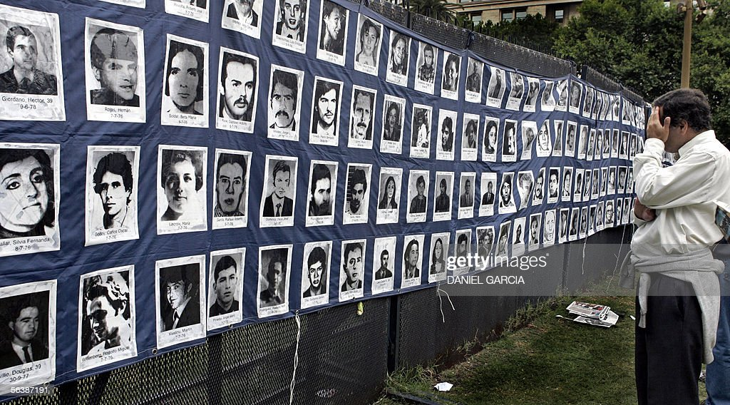 An man looks at pictures of missing peop : News Photo