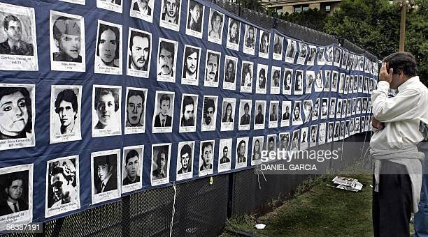 An man looks at pictures of missing people after a homage to one of the founders of the Organization of Mothers of Plaza de Mayo Azucena Villaflor 08...