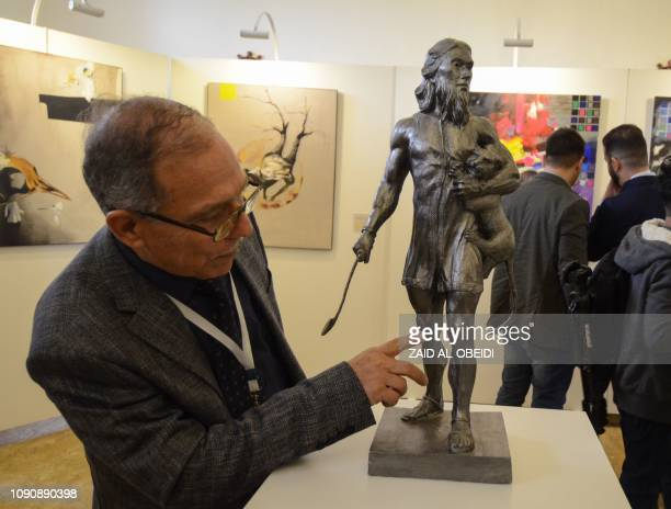 An man looks on January 29 2019 at a displayed sculpture at a contemporary art exhibition hall in the museum of the northern Iraqi city of Mosul...