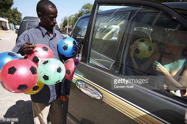 An man offers a woman footballs on December 12 2008 in Djibouti The african town Djibouti is the starting point for the german frigate Karlsruhe The...