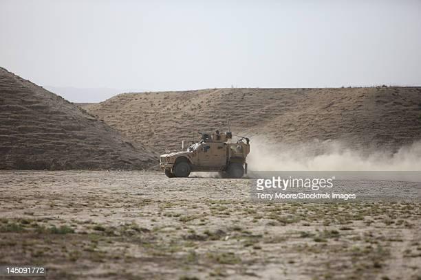 An M-ATV races across the wadi near Kunduz, Afghanistan.