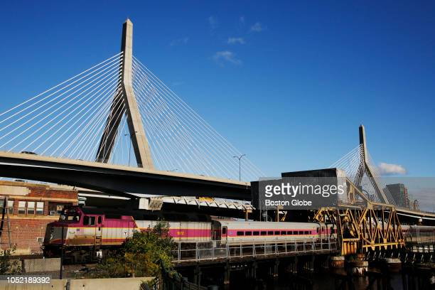 An MBTA Commuter Rail train passes over a drawbridge in Cambridge MA on Oct 12 2018 Last week the Massachusetts Bay Transportation Authority issued...