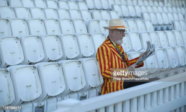 An MCC member reads a paper before the third day of the fifth Specsavers test match between England and Australia at the Kia Oval Cricket Ground on...