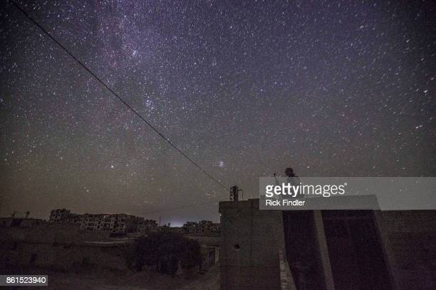 An MFS soldier sits on guard duty at his nocter on August 16 2017 on the front lines of western Raqqa Attacks on the nocter are common as ISIS try...