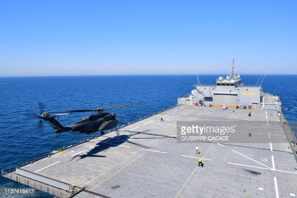 An MH53E Sea Dragon takes off from the Lewis B Puller carrier during a joint demining drill between the US British an French Navy in the Arabian Gulf...