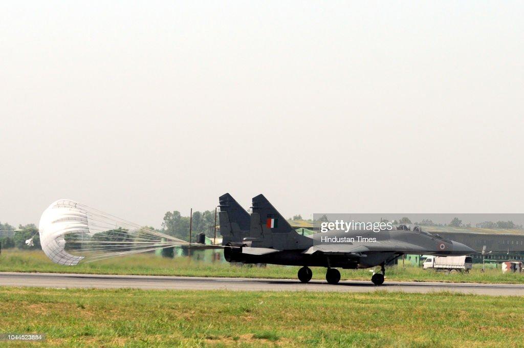 An MIG-29 lands at Adampur Air Base during preparations