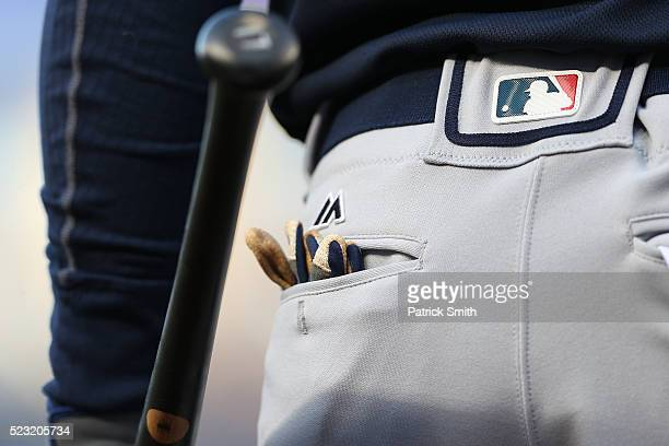 An MLB logo is seen on the pants of Majestic Athletic uniform of an Atlanta Braves player as they play the Washington Nationals at Nationals Park on...