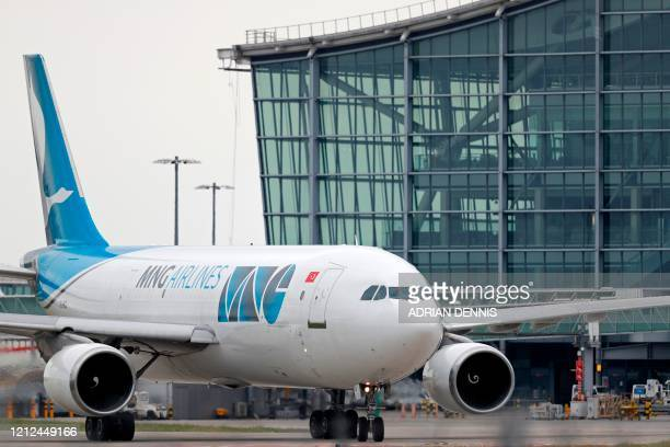 An MNG Airlines Airbus is pictured on the tarmac at London Heathrow Airport in west London, on May 10, 2020. - Britain could introduce a 14-day...