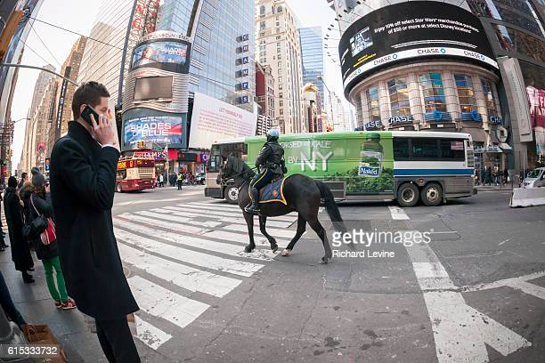 An mounted NYPD officer in New York patrols Times Square on Tuesday March 22 2016 Security in New York has been heightened in the wake of the...