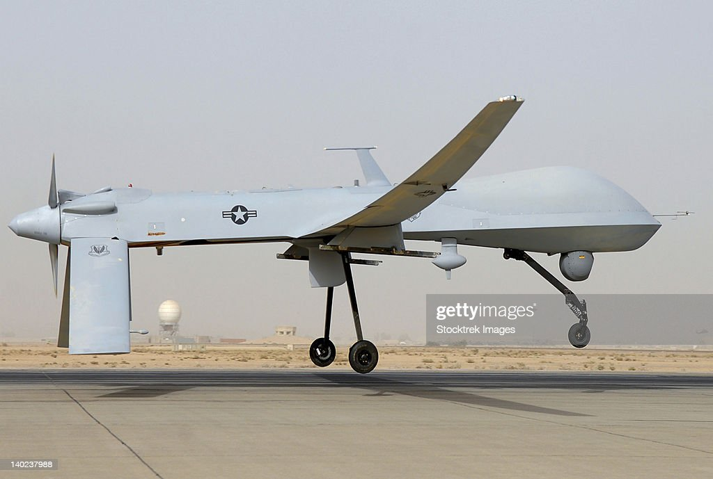 An MQ-1 Predator unmanned aircraft prepares for takeoff in support of operations in Southwest Asia. : Stock Photo