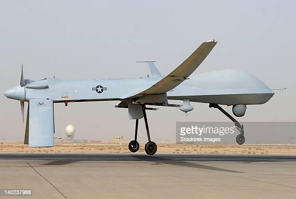 an mq-1 predator unmanned aircraft prepares for takeoff in support of operations in southwest asia. - military drones stock photos and pictures