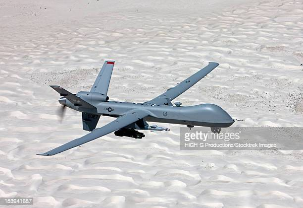 an mq-9 reaper flies a training mission over the white sands national monument in southern new mexico. - military drones stock photos and pictures