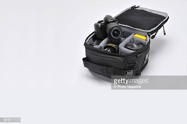 An MRock camera bag with a Nikon D3100 photographed on white taken on July 5 2012