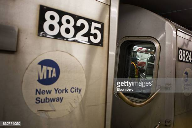 An MTA employee rides a train on the newly opened Second Avenue subway line in New York US on Sunday Jan 1 2017 The first train departed the 96th...