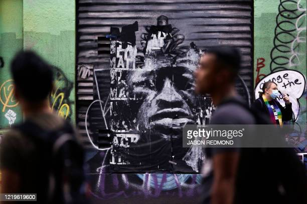 An mural of George Floyd is pictured in an area now called the Capitol Hill Autonomous Zone located on streets reopened to pedestrians after the...