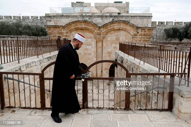 An Muslim cleric checks a gate closed by Israeli Police at the Al Aqsa mosque compound in Jerusalem's Old City on February 18 2019