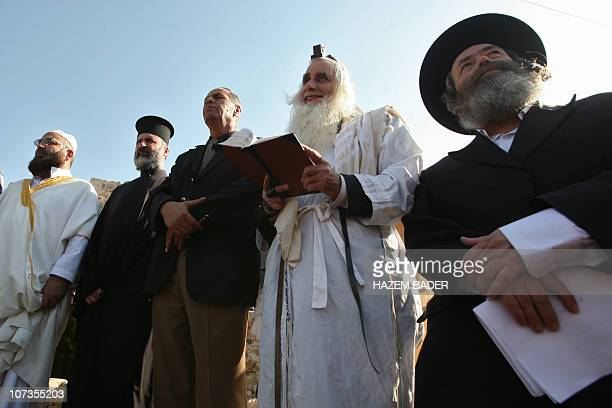 An Muslim imam a Christian priest and two Jewish rabbis join a prayer calling for rain on November 11 2010 in the West Bank village of Walajeh near...