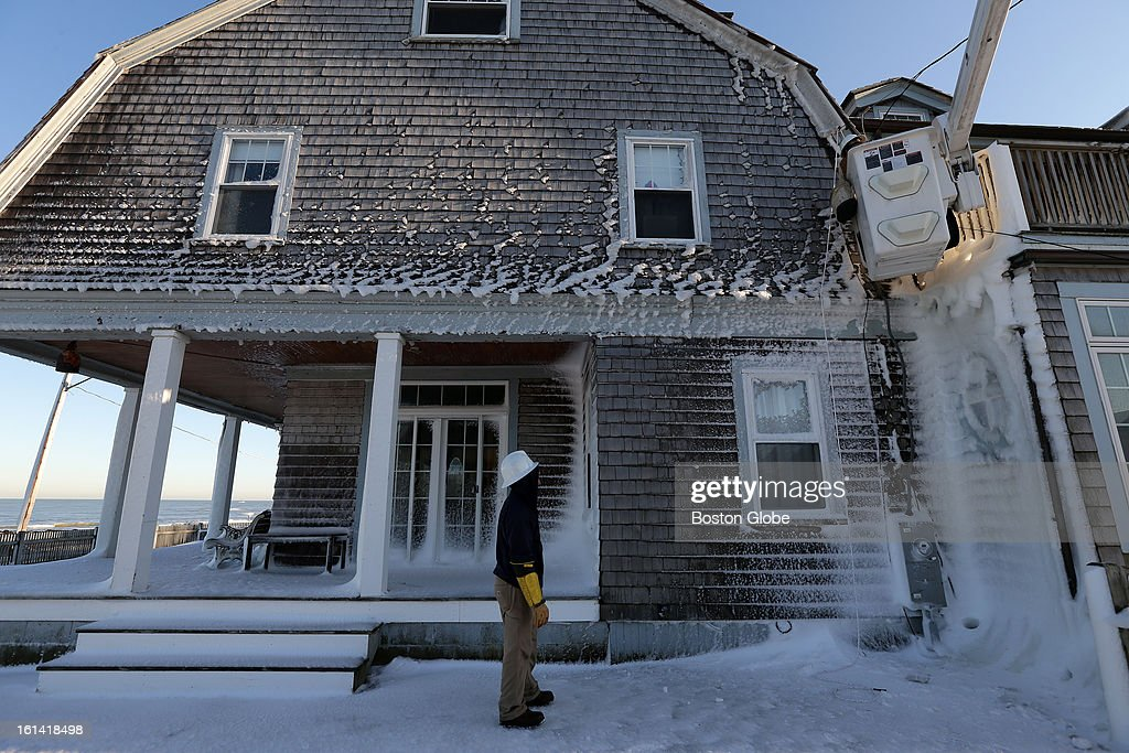 An N Star crew out of Boston works on a house on Ocean Street in Marshfield on Sunday, Feb. 10, 2013, after a blizzard hit New England.