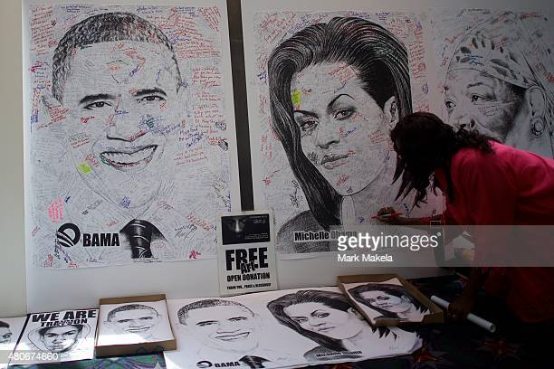 An NAACP convention attendee autographs a drawing of Michelle Obama on July 14 2015 in Philadephia Pennsylvania President Obama would later deliver a...