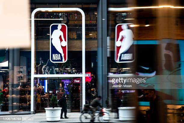 An NBA logo is shown at the 5th Avenue NBA store on March 12 2020 in New York City The National Basketball Association said they would suspend all...