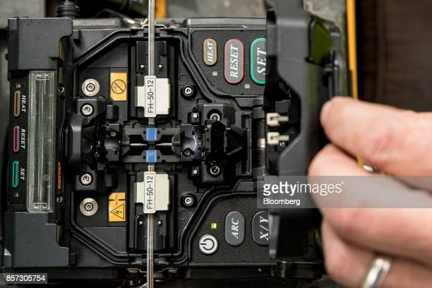 An NBN Co technician prepares optical fibers to be spliced during the installation of fibertothebuilding connections in Sydney Australia on Tuesday...