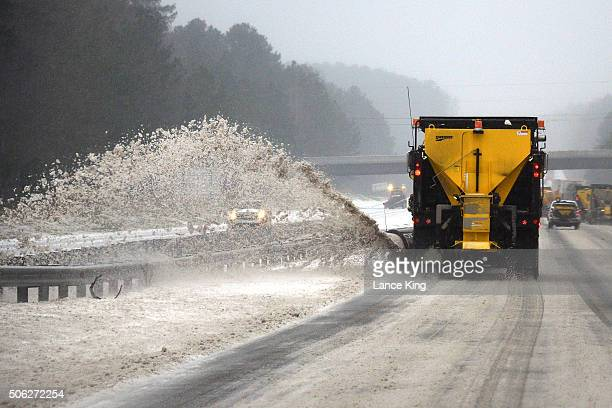 An NCDOT snow plow clears the roadway along Interstate 40 during a winter storm on January 22 2016 in Chapel Hill North Carolina A major snowstorm is...