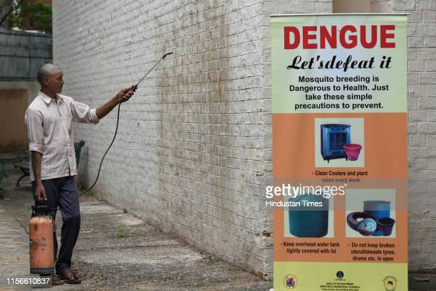 An NDMC worker sprays insecticides to prevent dengue and other vector borne diseases at NP Senior Secondary School Moti Bagh on July 19 2019 in New...