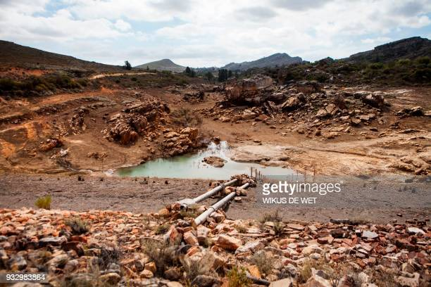 An nearly water empty dam is pictured on a farm in Piket Boberg Piketberg north of Cape Town on March 7 2018 as a result of a threeyearlong drought...