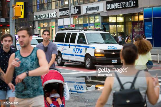 An New York Police Department vehicle drives past Union Square amid a rise of gun violence in New York, U.S., on Saturday, July 17, 2021. Last week,...