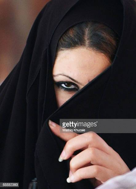 An newly married Iraqi woman looks on during a group wedding celebration in alMuhsin Shiite mosque August 6 2005 in the Sadr city neighborhood in...