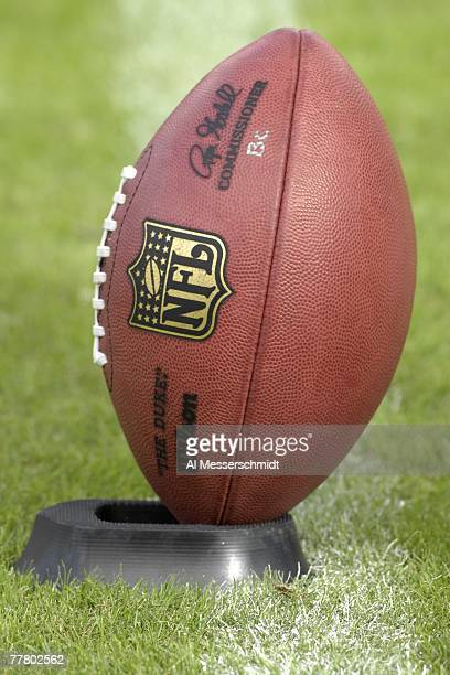 An NFL football sets on a kicking tee as the Tampa Bay Buccaneers host the Jacksonville Jaguars at Raymond James Stadium on October 28 2007 in Tampa...