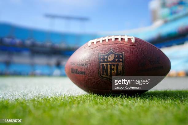 An NFL football with logo before the game between the Carolina Panthers and the Atlanta Falcons at Bank of America Stadium on November 17 2019 in...