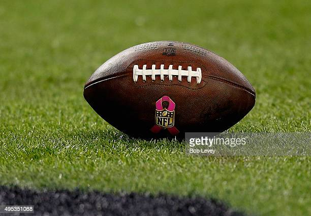 An NFL football with the breast cancer awareness logo lays on the fieldf at NRG Stadium on November 1 2015 in Houston Texas