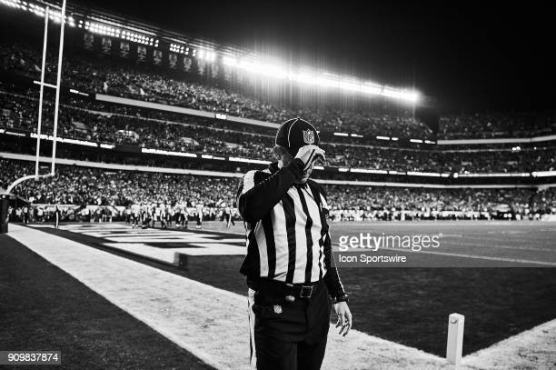An NFL referee is seen adjusting his cap during the NFC Championship Game between the Minnesota Vikings and the Philadelphia Eagles on January 21...