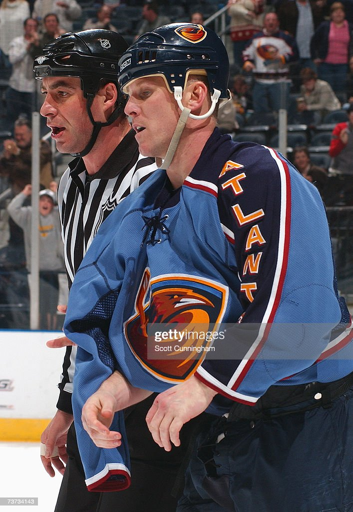 An Nhl On Ice Official Escorts Keith Tkachuk  Of The Atlanta Thrashers During