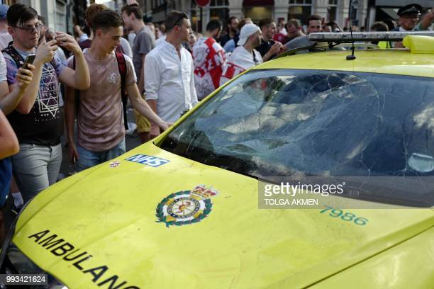 An NHS ambulance shows signs of damage after it is climbed on by celebrating fans in the street beside Borough Market after England's win over Sweden...