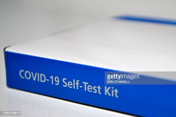 An NHS Covid-19 Self-Test Kit, containing a lateral flow test, is arranged for a photograph in Brenchley, south east England, on April 5, 2021. -...