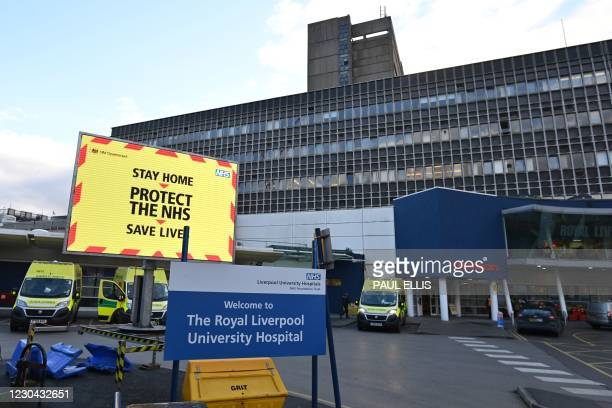 An NHS digital display shows a Covid warning outside Royal Liverpool University hospital in Liverpool, north west England on January 5 as Britain...